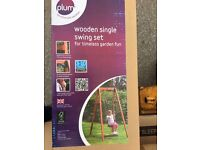 Plum Wooden swing. Brand new & Boxed