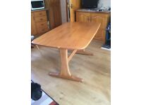 Ercol beech/elm dining table. 5ft.x3ft.very good condition