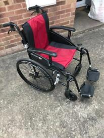 Excel g logic light weight self propelled wheelchair in red and black inc never used rain cover