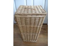 Wicker laundry basket with white fabric liner and handled lid and side handles- from smoke free home