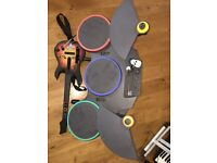 Nintendo WII with Guitar Hero, Drums, Wii fit and games and accessories