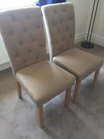 Pair of Light beige padded chairs will separate