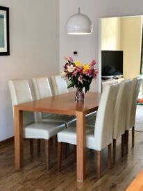 Wooden veneer Dining Table, 6 Chairs and Sideboard.