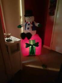 Inflatable roating snowman