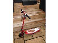 Razor E100 rechargeable scooter and charger. Excellent condition