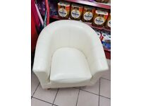 2 cream leather bucket chairs.