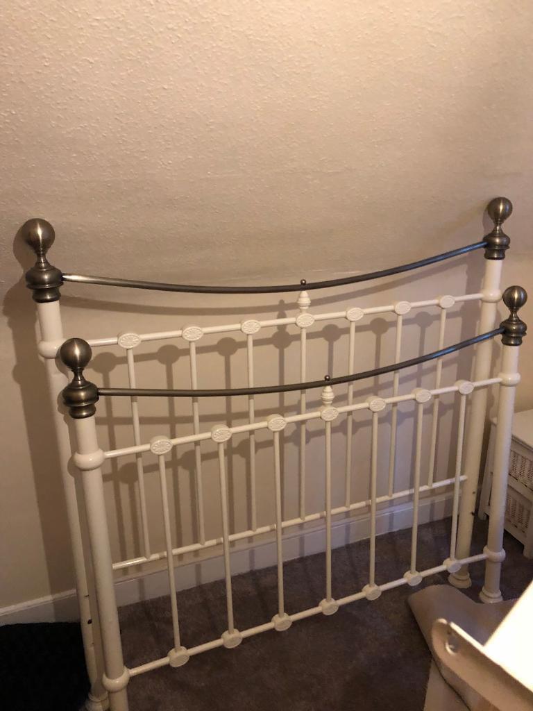 Cream metal double bed