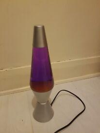 Yellow Lava Lamp in Purple Fluid