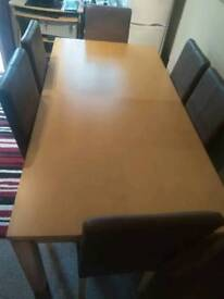 Light oak dining table and 6 leather dark brown dining chairs
