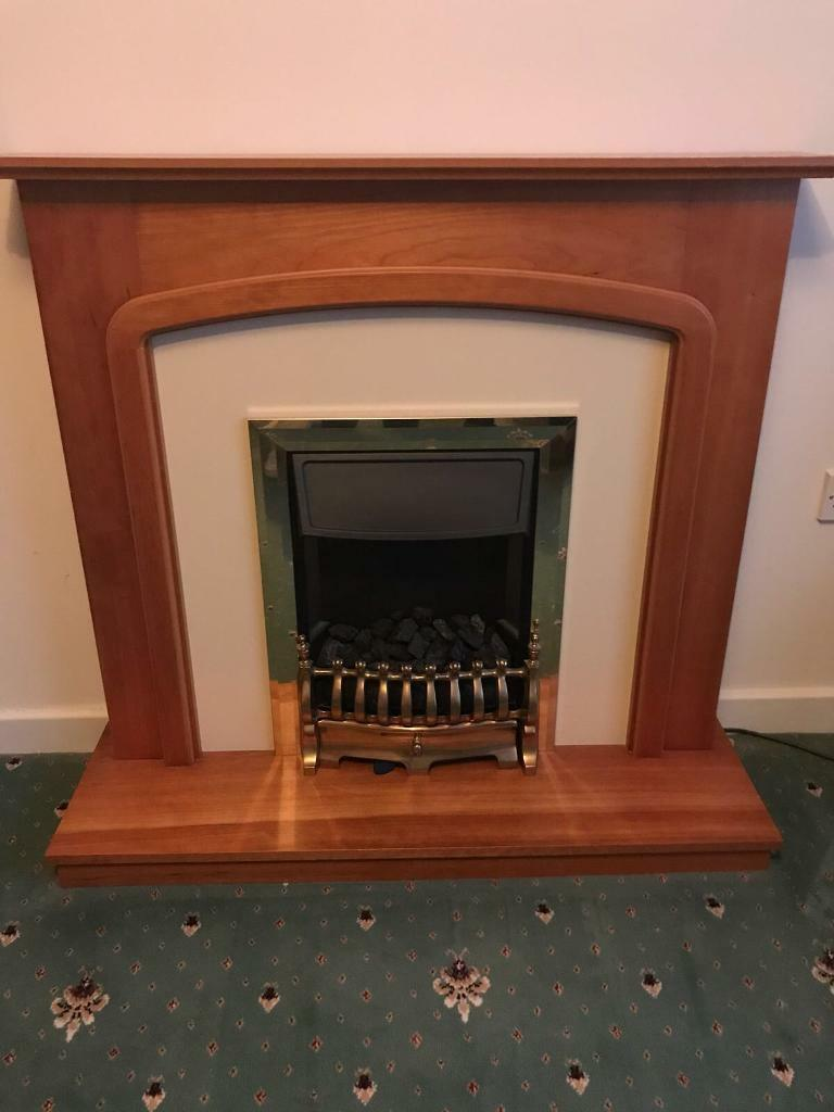 Electric fire and surrounding mantle