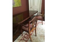 Extendable dining table and two carver chairs for sale