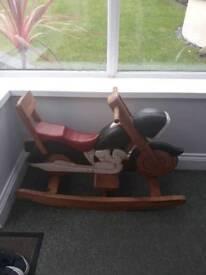 Child's wooden rocking motorbike