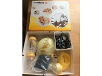 Medela electric breast pump and brand new storage set