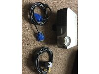Mini projector with carry case and leads.