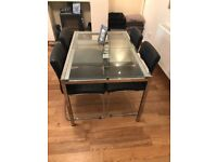 IKEA dining table and 4 British Home Stores black chairs