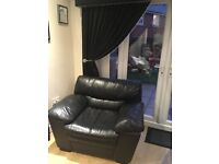 Black leather sofa and chair from Dfs
