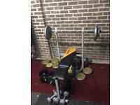 Bench press , iron weights around 40kg and bar