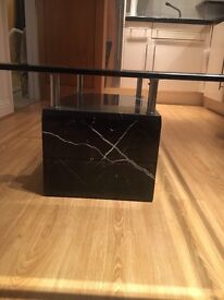 Large glass coffee table with marble base