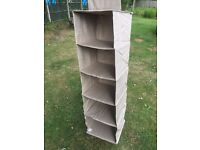 Taupe canvas hanging shelving.