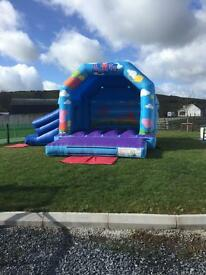Bouncy castle with slide for sale. Bouncy castles business