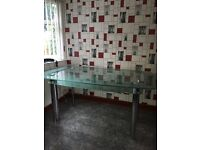 Glass table with Crome legs