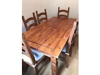 Wooden pine dining table and six chairs