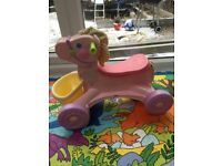 Fisher price Pink horse ride walker