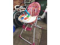 Babyweavers High chair with a toy