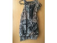 More of the bundle of clothing quiz dresses short jump suits size 14-16 hardly worn