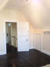 BRIGHT LARGE ATTIC ROOM at the top of old Edwardian house to let now.