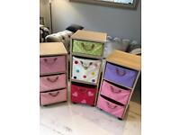 3 Toy/storage units on casters with multicoloured baskets