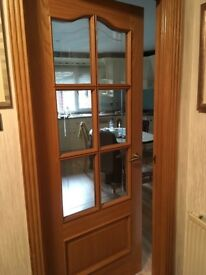 INTERNAL OAK DOOR, VALENCIA STYLE, WITH 6 CLEAR GLASS PANES, FACTORY PREFINISHED WITH CLEAR LACQUER