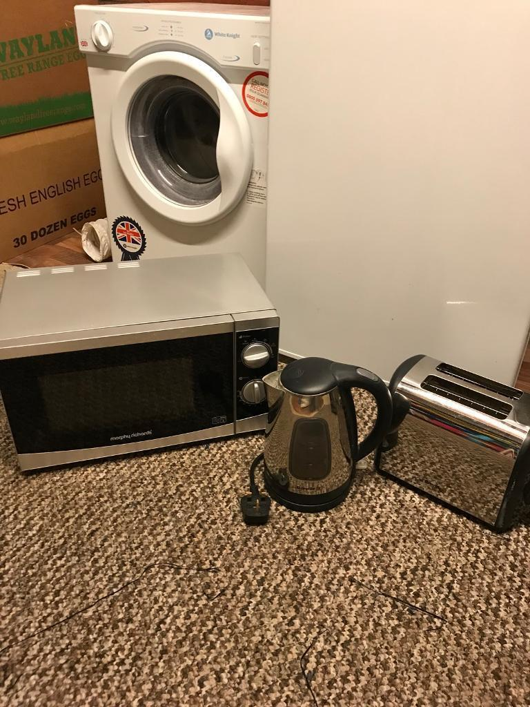 Microwave. Kettle and toaster. All in silver. Good condition.