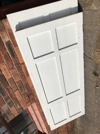 2 white panel doors - used - rebate