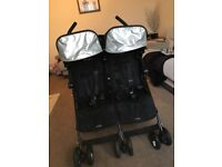MCCLAREN TWIN BUGGY IN VGC BLACK WITH RAIN COVER AND 1 FOOT MUFF £75 COLLECTION ONLY
