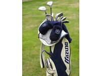 Golf clubs and bag. Dunlop Exceed irons 3-SW. Mitsushiba 1-w and 3-w. All graphite shafts.