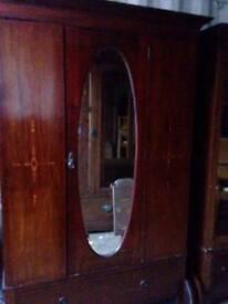 Mahogany inlaid wardrobe and matching dressing chest