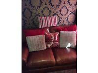 2 pair red 90x90 curtains/ 11 red and gold cushions /flower arrangement
