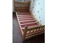 Pine single bed.