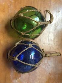 Coloured glass orbs with rope hangers