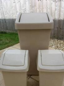 Bins. 2 small, 1 large. Kitchen/bathroom