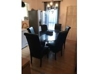 Black dining table with chairs