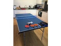 Table tennis table + assorted paddles and balls