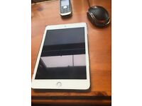 I Pad mini 4, as new, with a gold case and holder. Never left the house only used a few times. 16GB