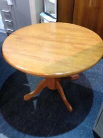 Good quality round extending dining table