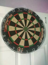 Dart board and pool cue