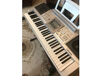 Digital piano keyboard with stand