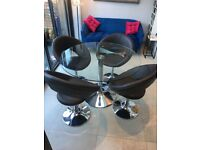 Dwell glass dining table and 4 swivel chairs