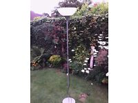 IKEA floor standing lamp, silver effect with white shade uplighter. Adjustable height on/off switch