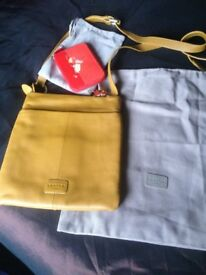 Real Radley bag and purse with tags never been used 30 pound